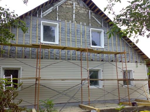 обшивка сайдингом деревянного дома